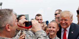 ・・・ President Donald  greeted members of the military on the tarmac upon his a...