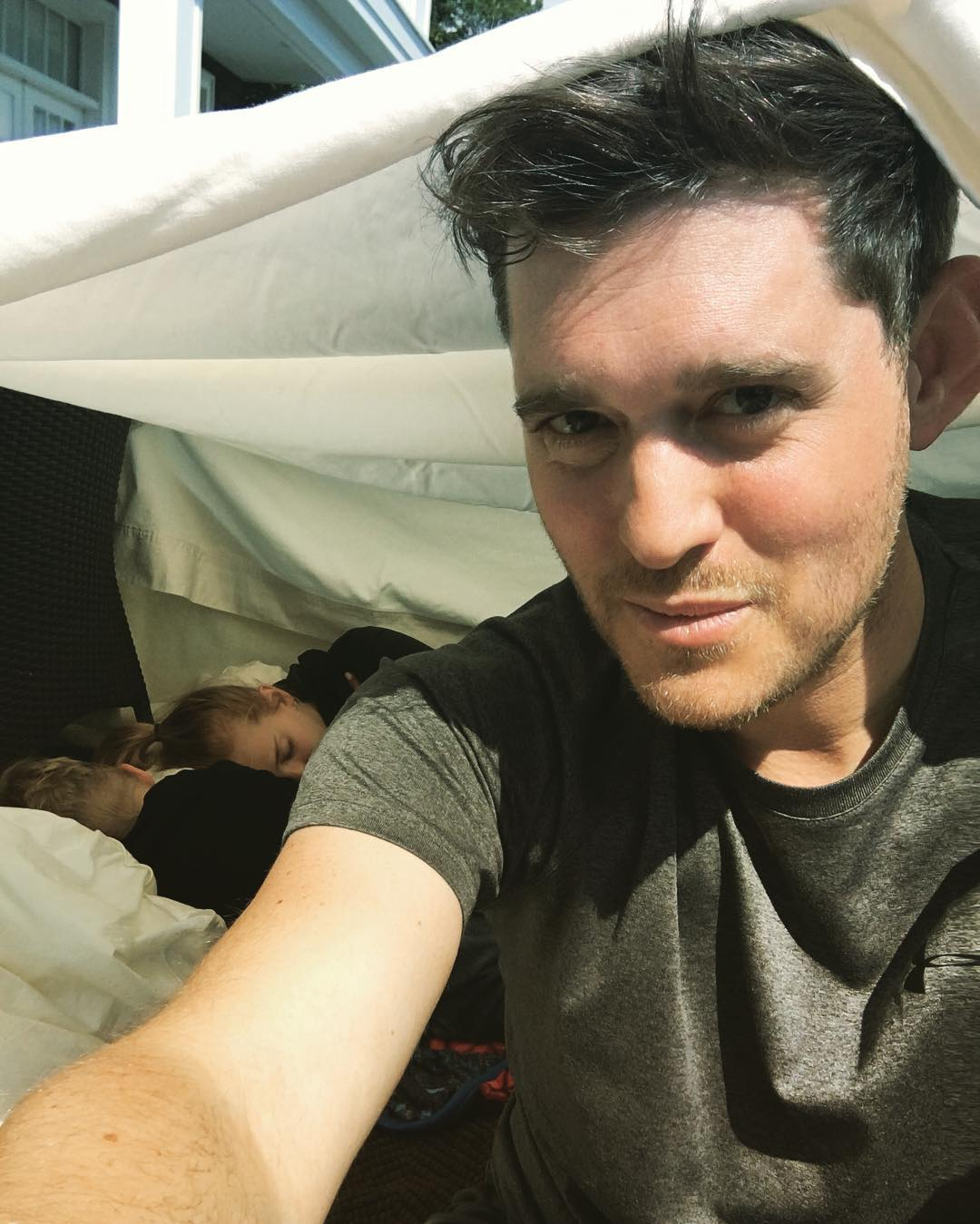 Michael Bublé Instagram: We built a tent made of bed sheets and camped outside our house today !! This is...