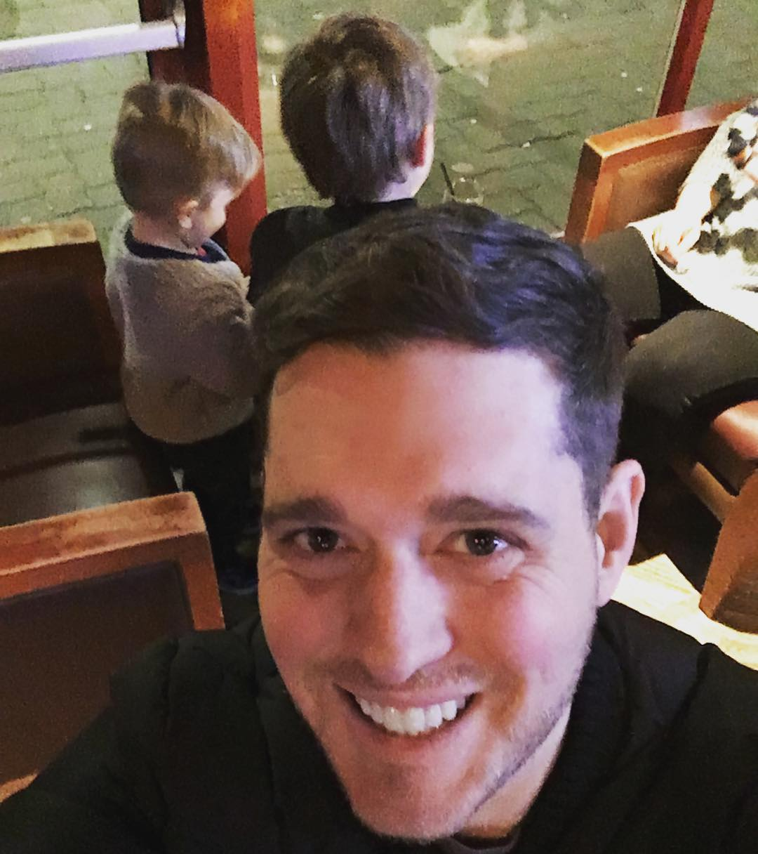 Michael Bublé Instagram: You know you're  a dad when ... You watch the Super Bowl with your kids at the k...