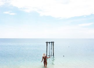 Tip toeing over pointy coral to get to this beauty, a swing and the sea. Could t...