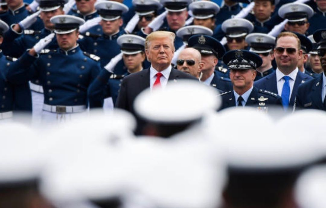 Donald J. Trump Instagram: COLORADO SPRINGS, CO - MAY 30: President Donald Trump watches as graduating cade...