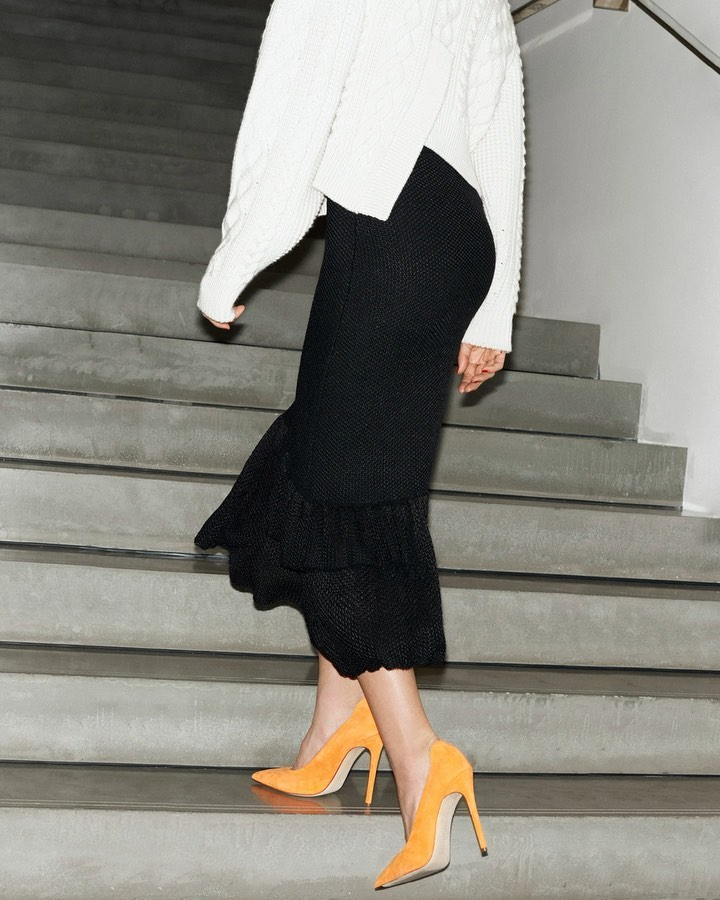 Victoria Beckham Instagram: Chunky, cabled knits perfect to layer or wear alone, paired with the orange VB p...