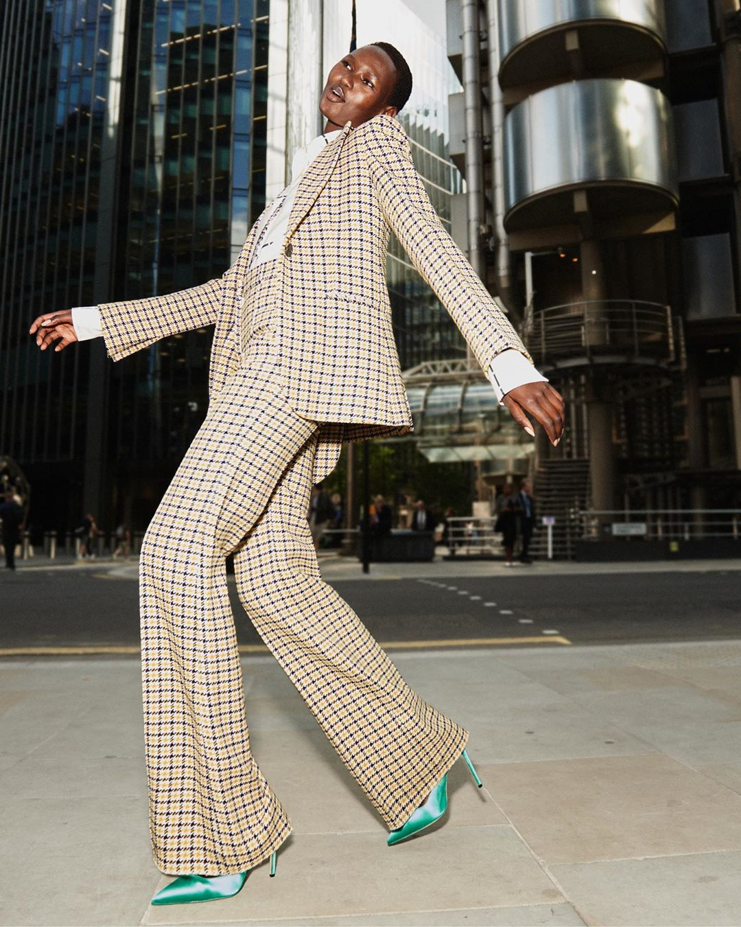 Victoria Beckham Instagram: A polished pantsuit marries British heritage fabrics with a 1970s silhouette for...